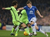 Everton's Seamus Coleman takes on Manchester City's David Silva (L) during the League Cup semi-final first leg at Goodison Park on January 6, 2016
