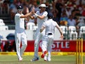 Stuart Broad and James Anderson celebrate taking the wicket of AB de Villiers on day three of the second Test between South Africa and England on January 4, 2016
