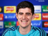 Thibaut Courtois flashes a smile in the direction of an obsessed reporter at a Chelsea press conference on December 8, 2015