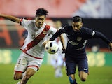 Rayo Vallecano's Zhang Chengdong vies with Atletico Madrid's Yannick Ferreira Carrasco on January 6, 2016
