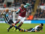 Angelo Ogbonna Obinza of West Ham United competes for the ball against Jonjo Shelvey and Aleksandar Mitrovic of Newcastle United at St James' Park on January 16, 2016