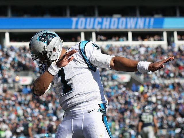 A visibly cold Cam Newton celebrates during the game between Seattle Seahawks and Carolina Panthers on January 17, 2016