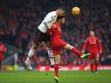 Chris Smalling of Manchester United wins a header from Adam Lallana of Liverpool on January 17, 2016