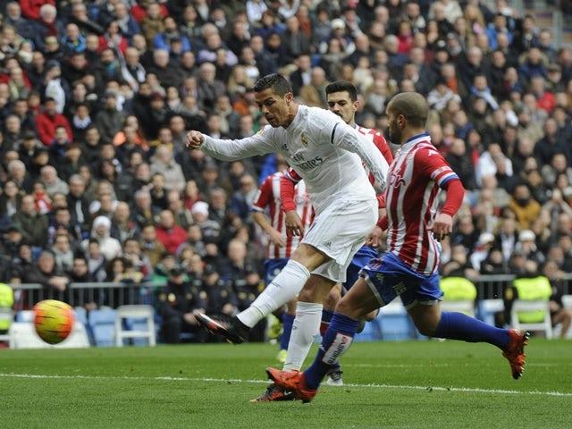 Real Madrid's Cristiano Ronaldo kicks to score against Sporting Gijon on January 17, 2016