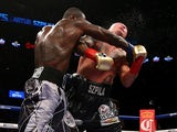 Deontay Wilder punches Artur Szpilka during their WBC Heavyweight Championship bout at Barclays Center on January 16, 2016