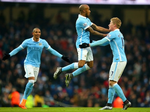 Fabian Delph celebrates with little Kevin de Bruyne during the game between Man City and Crystal Palace on January 16, 2016