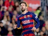 "Tanned, 6'4"" defender Gerard Pique in action during the game between Barcelona and Athletic Bilbao on January 17, 2016"