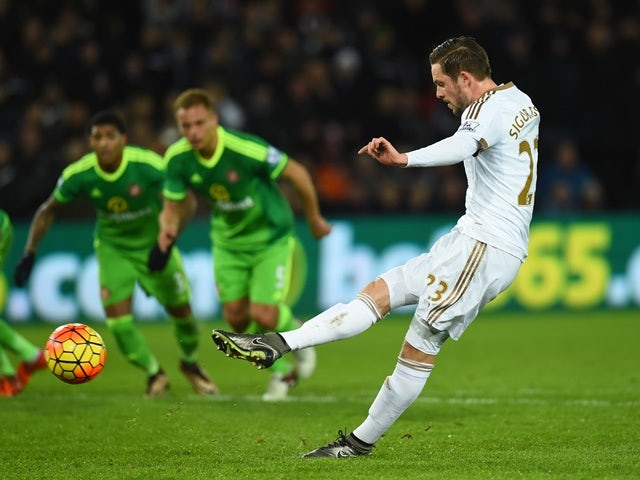 Gylfi Sigurdsson of Swansea City converts the penalty to score his team's first goal against Sunderland at the Liberty Stadium on January 13, 2016