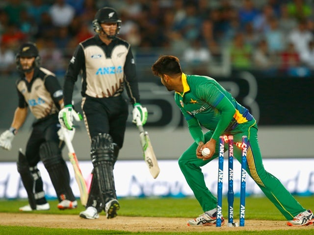 Imad Waseem of Pakistan runs out Martin Guptill of New Zealand during the first T20 match at Eden Park on January 15, 2016