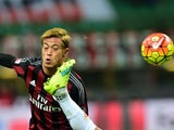 Keisuke Honda in action with Kenny Everett during the game between Milan and Fiorentina on January 17, 2016