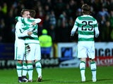 Leigh Griffiths of Celtic celebrates scoring a goal against Dundee United at Tannadice Park on January 15, 2016
