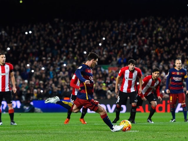 Lionel Messi scores from the penalty spot during the game between Barcelona and Athletic Bilbao on January 17, 2016