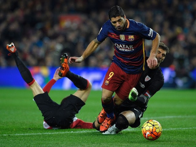 Luis Suarez is hacked down by Gorka Iraizoz during the game between Barcelona and Athletic Bilbao on January 17, 2016