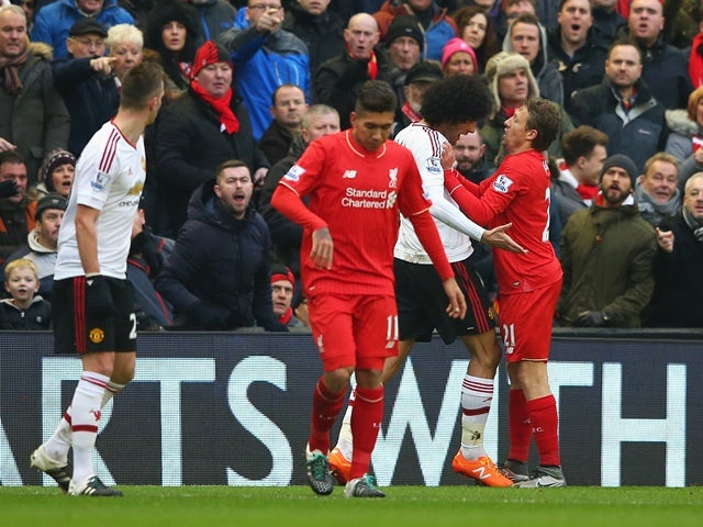 Marouane Fellaini of Manchester United clashes with Lucas Leiva of Liverpool on January 17, 2016
