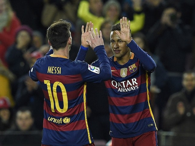 Neymar celebrates with Lionel Messi during the game between Barcelona and Athletic Bilbao on January 17, 2016