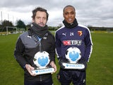 Quique Sanchez Flores and Odion Ighalo with their Manager and Player of the Month awards for December 2015