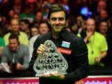 Ronnie O'Sullivan poses with the Masters trophy on January 17, 2016