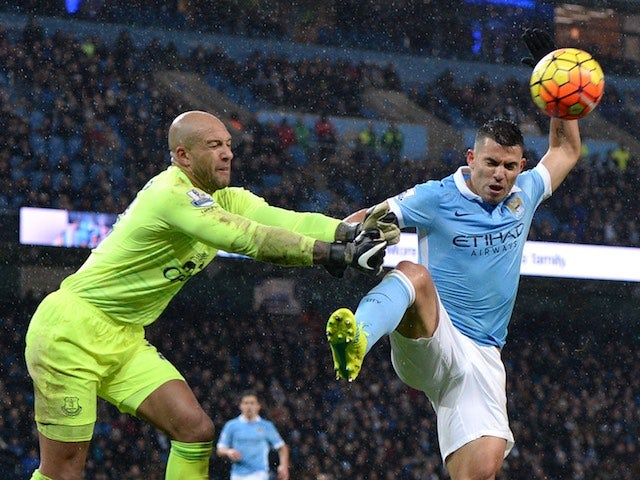 Sergio Aguero takes his turn to have a pop at Tim Howard during the game between Man City and Everton on January 13, 2016