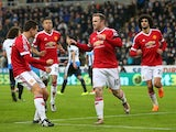 Wayne Rooney celebrates with teammates as he scores Manchester United's first goal from the penalty spot during the Premier League match against Newcastle United at St James' Park on January 12, 2016