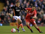 Exeter City's Alex Nicholls and Liverpool's Kevin Stewart during the FA Cup third-round replay on January 20, 2016