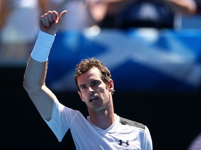 Andy Murray sticks a thumb up on day two of the Australian Open on January 19, 2016