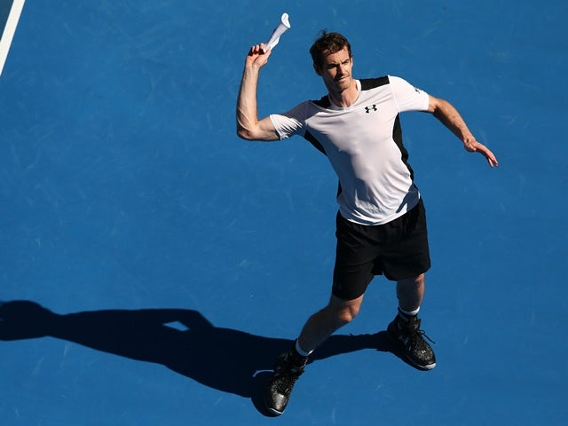 Andy Murray celebrates match point in his second-round match against Sam Groth during day four of the 2016 Australian Open  on January 21, 2016