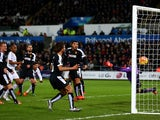 Ashley Williams scores the opening goal during the game between Swansea and Watford on January 18, 2016