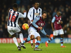 Joleon Lescott of Aston Villa and Saido Berahino of West Bromwich Albion compete for the ball on January 23, 2016
