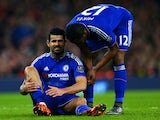 Diego Costa sits on the turf injured before being substituted during the Premier League match between Arsenal and Chelsea on January 24, 2016