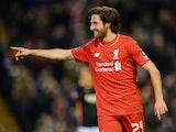 Liverpool's Joe Allen celebrates after scoring the opening goal against Exeter City on January 20, 2016