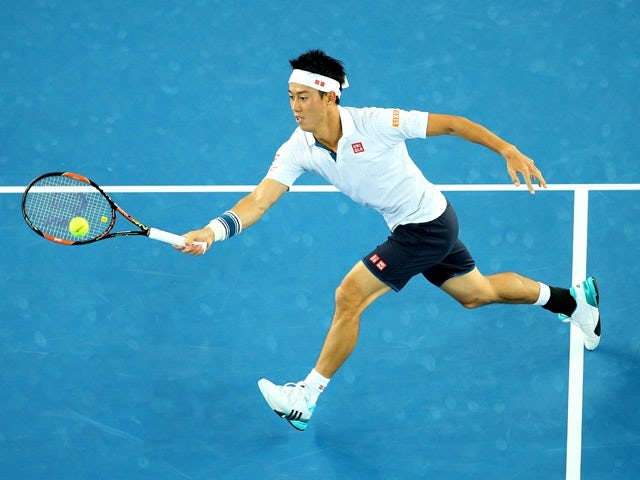 Kei Nishikori plays a forehand in his second-round match against Austin Krajicek during day three of the 2016 Australian Open on January 20, 2016