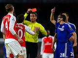 Referee Mark Clattenburg shows a red card to Per Mertesacker of Arsenal on January 24, 2016