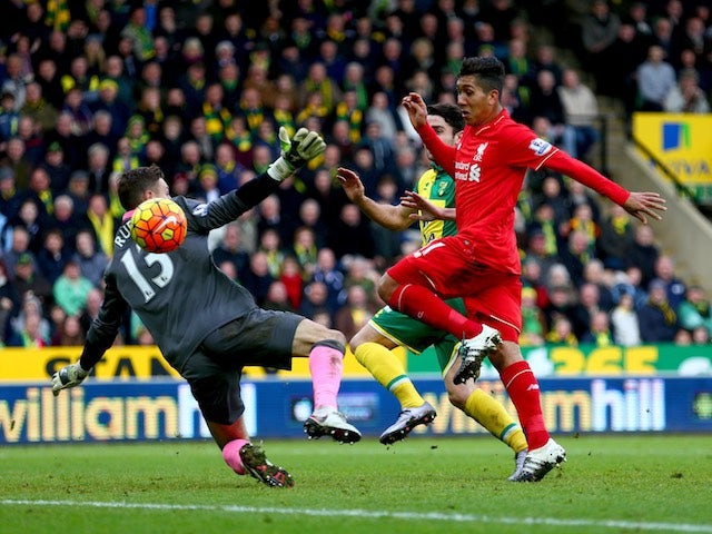 Roberto Firmino scores Liverpool's third goal during the Premier League match against Norwich City on January 23, 2016