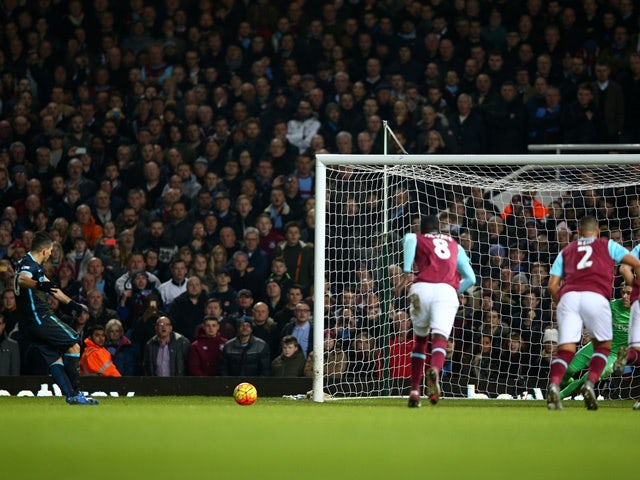 Sergio Aguero of Manchester City converts the penalty to score his team's first goal against West Ham United and Manchester City at the Boleyn Ground on January 23, 2016