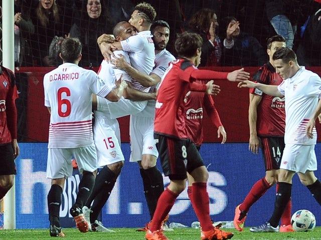 Sevilla players celebrate a goal against Mirandes at the Ramon Sanchez Pizjuan stadium in Sevilla on January 21, 2016