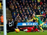 Norwich City's Steven Naismith scores against Liverpool in the Premier League on January 23, 2016