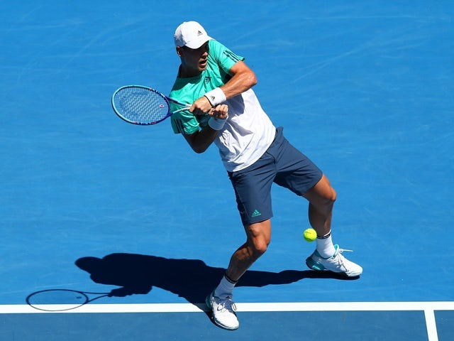 Tomas Berdych plays a backhand in his second-round match against Mirza Basic during day three of the 2016 Australian Open  on January 20, 2016