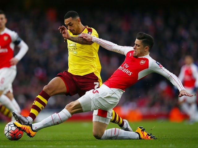 Andre Gray and Gabriel compete for the ball during FA Cup fourth-round match between Burnley and Arsenal on January 30, 2016