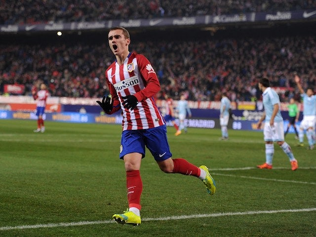 Antoine Griezmann celebrates scoring during the Copa del Rey game between Atletico Madrid and Celta Vigo on January 27, 2016
