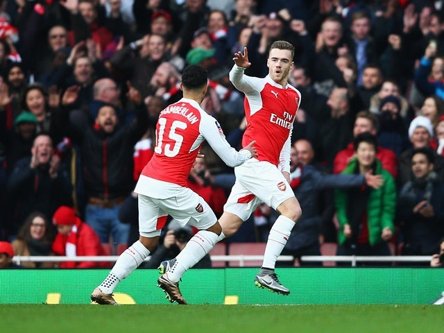 Calum Chambers of Arsenal celebrates scoring his team's first goal against Burnley at the Emirates Stadium on January 30, 2016