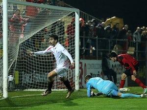 Sevilla cruise into semi-finals