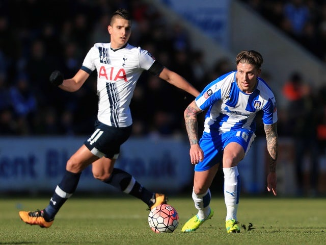 George Moncur of Colchester United and Erik Lamela of Tottenham Hotspur compete for the ball on January 30, 2016