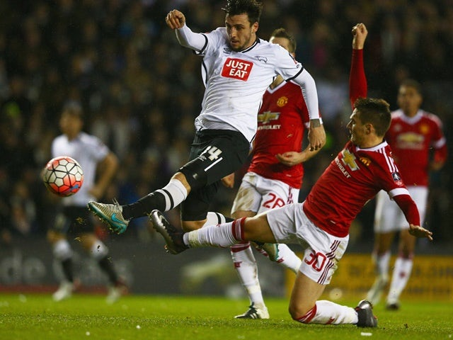 George Thorne beats Guilermo Varela to score during the Emirates FA Cup fourth-round match between Derby County and Manchester United at iPro Stadium on January 29, 2016