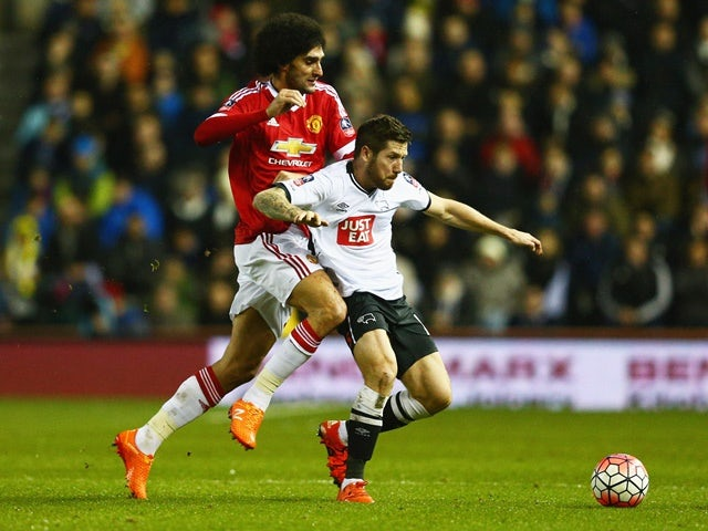 Jacob Butterfield and Marouane Fellaini in action during the FA Cup fourth-round match between Derby County and Manchester United at iPro Stadium on January 29, 2016