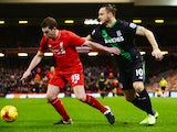 Jon Flanagan and Marko Arnautovic tussle for the ball during the League Cup semi-final second leg between Liverpool and Stoke City at Anfield