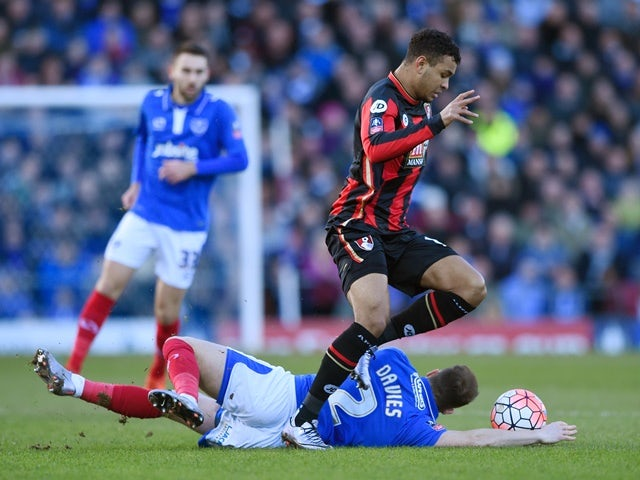 Joshua King of Bournemouth and Ben Davies of Portsmouth compete for the ball on January 30, 2016