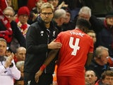 Jurgen Klopp taps Kolo Toure during the League Cup match between Liverpool and Stoke City on January 26, 201
