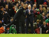 Jurgen Klopp and Mark Hughes shake hands during the League Cup match between Liverpool and Stoke City on January 26, 2016