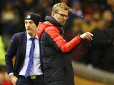 Jurgen Klopp of Liverpool signals as Slaven Bilic of West Ham United doesn't during the FA Cup fourth-round match on January 30, 2016