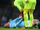 Kevin De Bruyne screams in pain during the League Cup game between Manchester City and Everton on January 27, 2016
